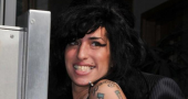 Amy Winehouse checks herself out of rehab