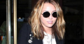 Intruder arrested after approaching Miley Cyrus' house armed with scissors