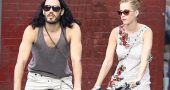 Katy Perry and Russell Brand biking