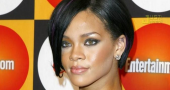Rihanna talks Chris Brown and Drake fighting for 'her love'