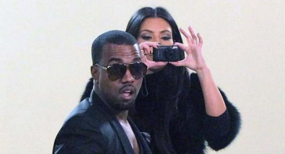 Kanye West looks embarrassed to be supporting girlfriend Kim Kardashian