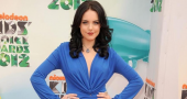 Elizabeth Gillies' is a 70's beauty in low-cut disco red blouse for tv show