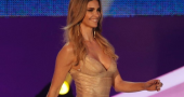 Fernanda Lima helps Sepp Blatter at the opening of the 64th FIFA congress