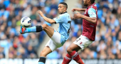Gael Clichy warns Arsenal that Man City haven't given up title challenge