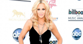 Jenny McCarthy's gorgeous legs heat up Hard Rock casino in fuchsia dress