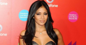 Nicole Scherzinger mesmerizes viewers in dress while shooting crossbow