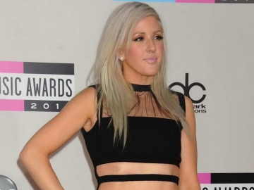 Ellie Goulding a rock'n'roll fashion star in ripped trousers at Moschino show