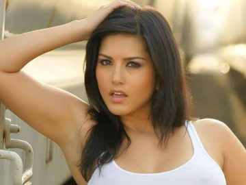 Sunny Leone a Mandate Magazine bombshell beauty in one-piece swimsuit