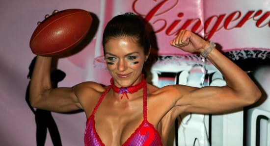 Adrianne Curry posing in lingerie with football