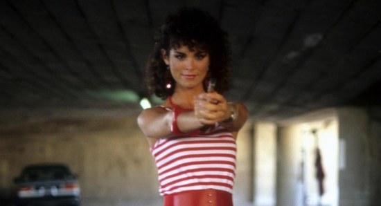 Betsy Russell looking risque and dangerous
