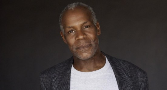 Danny Glover in jeans and a blazer