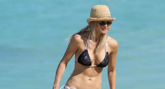 Elin Nordegren on beach in black bikini