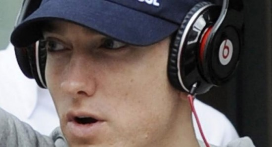Eminem wearing beats headphones from his mentor Dr. Dre's company