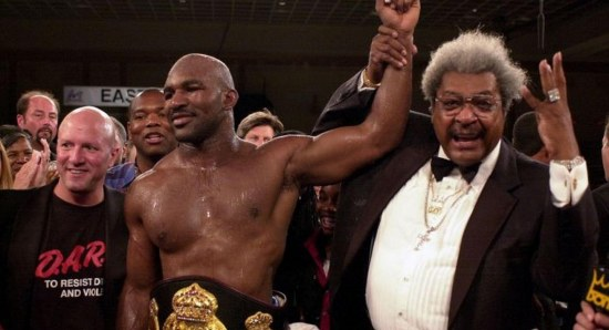 Evander Holyfield with promoter Don King