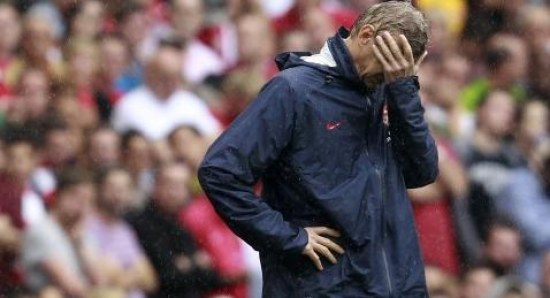 A distraught Arsene Wenger