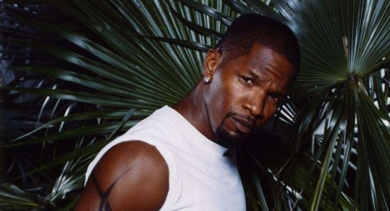 Jamie Foxx posing in jeans and white shirt