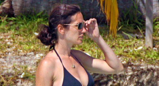 Jennifer Connelly in blue bikini with sunglasses