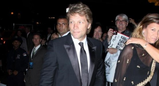 Jon Bon Jovi walking with wife