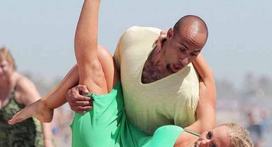 Kendra Wilkinson and Hank Baskett fooling about at the beach