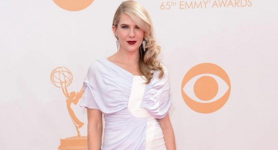 Lily Rabe in white dress on red carpet