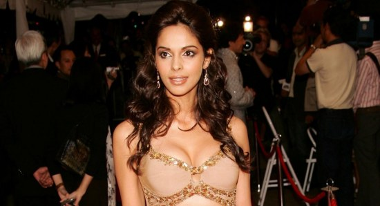 Mallika Sherawat posing in nude coloured outfit