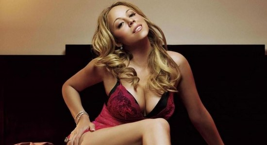 Mariah Carey posing in red lingerie