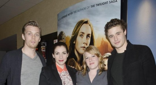 Jake Abel, Max Irons, and Stephenie Meyer with a fan at an autograph signing