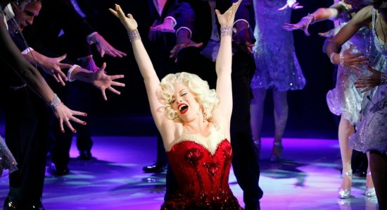 Megan Hilty performing in red dress