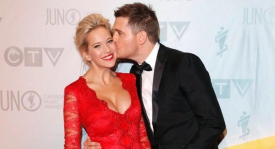 Michael Buble and wife in red dress