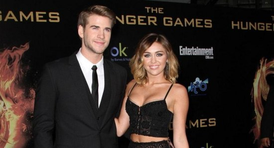 Miley Cyrus and Liam Hemsworth at the premiere of the Hunger Games