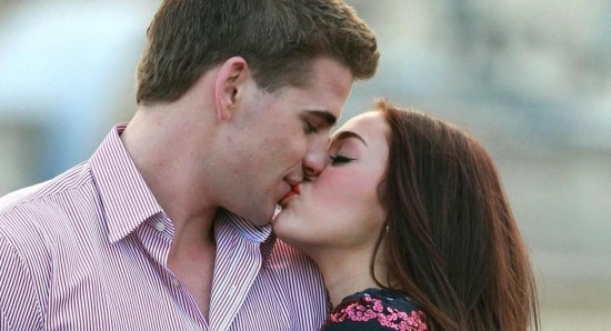 Miley Cyrus and Liam Hemsworth at happier times