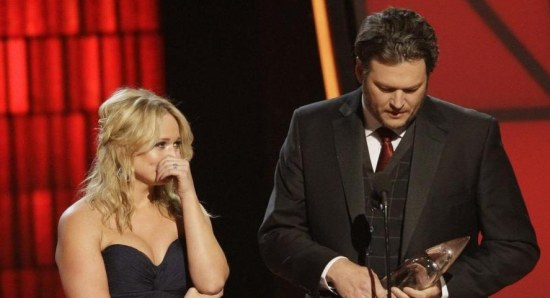 Blake Shelton receives an award on stage