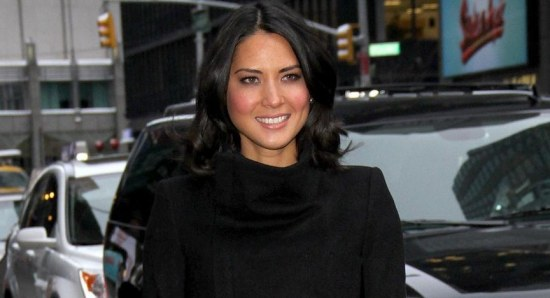 Olivia Munn smiling for photographers