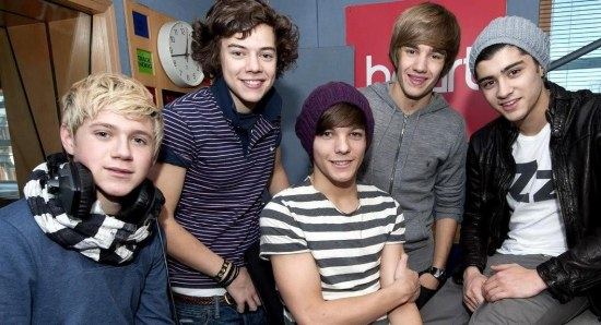 The One direction boys at a radio station