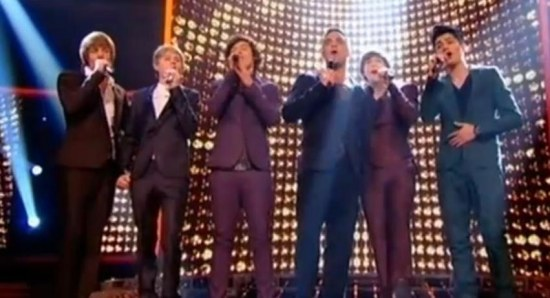 One Direction performing with Robbie Williams