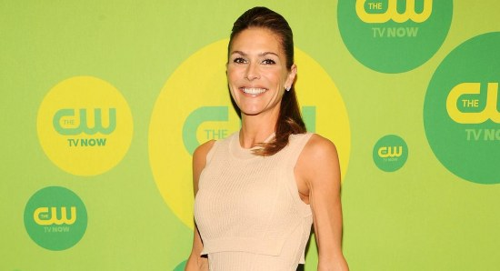 Paige Turco in nude coloured dress