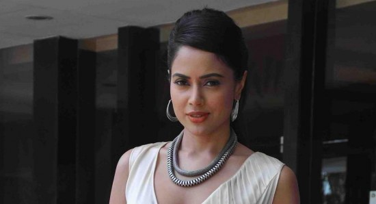 Sameera Reddy modelling white gown