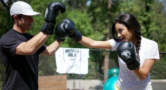 Shay Mitchell boxing with trainer
