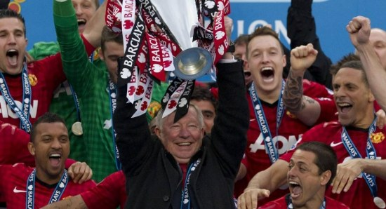 Sir Alex Ferguson with one of his many trophies