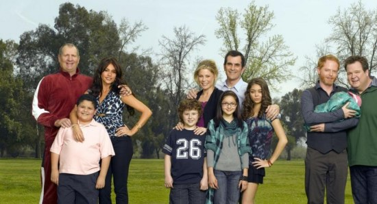 The cast of Modern Family pose for a photoshoot