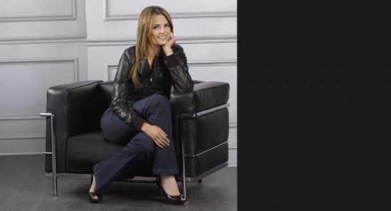 Stana Katic looking relaxed in chair for photo