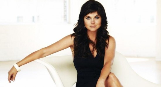Tiffani Thiessen modelling black dress