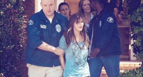 Emma Watson's character being arrested by the police