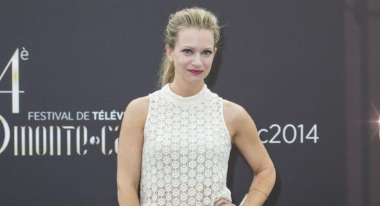 A.J. Cook posing in white sleeveless blouse