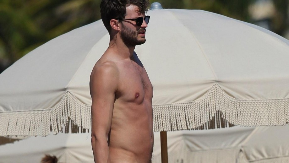 Fifty Shades of Grey star Jamie Dornan compares Christian Grey to a Superhero