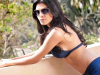 Sherlyn Chopra sultry gun photo without clothes stuns Indian film fans