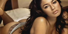 Jessica Gomes is a sultry Aussie sensation in black one-piece swimsuit