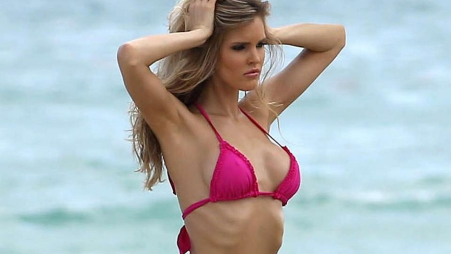 Charlotte McKinney stuns in new GUESS swimsuit photos
