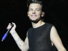 Louis Tomlinson admits he has struggled with fame