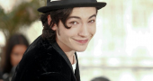 Ezra Miller is loving every minute of playing The Flash